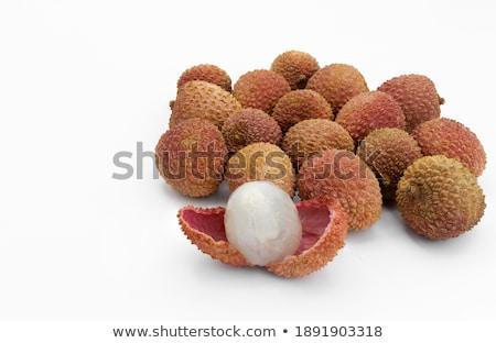 Een vers Rood rijp tropische vruchten geïsoleerd Stockfoto © artjazz