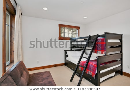 Bunk room with wooden bunkbeds dressed with crisp white bed linens  Stock photo © iriana88w