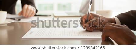 ビジネスマン 座って 署名 契約 ビジネス ストックフォト © Minervastock