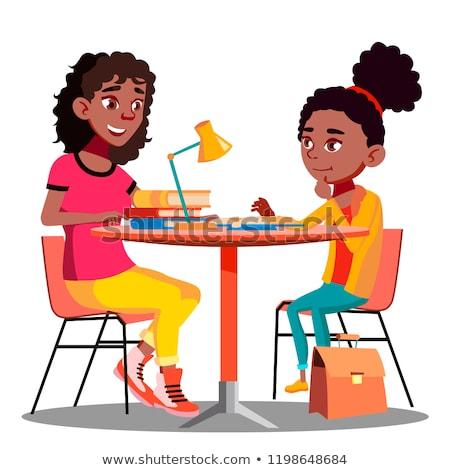 Stockfoto: A cute Black girl doing homework at home