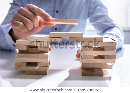 businessman building bridge to connect two towers stock photo © andreypopov