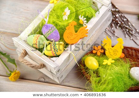 chocolate easter eggs in straw nest on table Stock photo © dolgachov