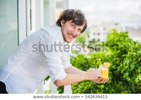ананаса коктейль ломтик рук человека терраса Сток-фото © galitskaya