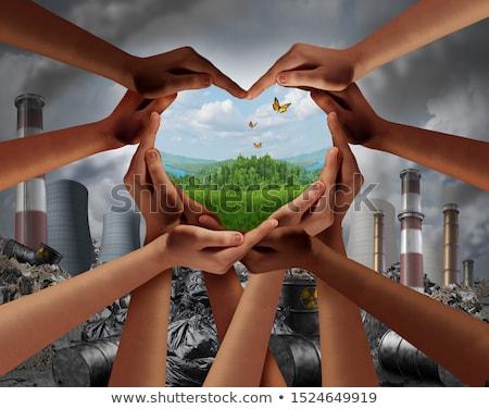 Föld napja csoport sokoldalú emberek űrlap szív Stock fotó © Lightsource