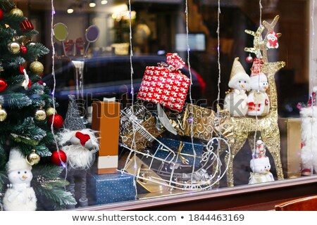Santa, snowman and reindeer celebrate Christmas on a city street Stock photo © liolle