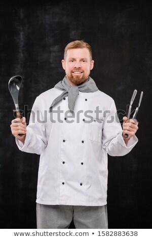 молодые повар равномерный кухонные принадлежности Сток-фото © pressmaster