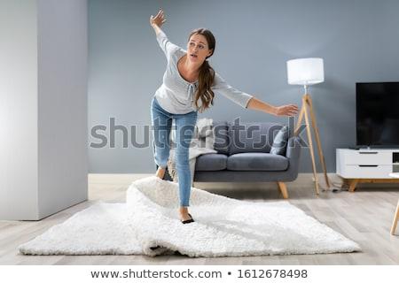 Mulher pernas tapete foto sala de estar casa Foto stock © AndreyPopov