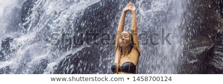 Woman traveler on a waterfall background. Ecotourism concept BANNER, LONG FORMAT Stock photo © galitskaya