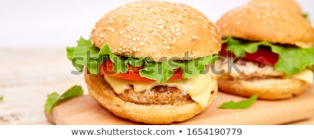 Banner of Craft beef burger on wooden table on light background Stock photo © Illia