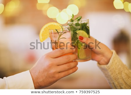 People holding colorful cocktails in a bar Stock photo © Kzenon