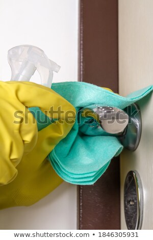 man disinfecting the handle of the front door Stock photo © nito