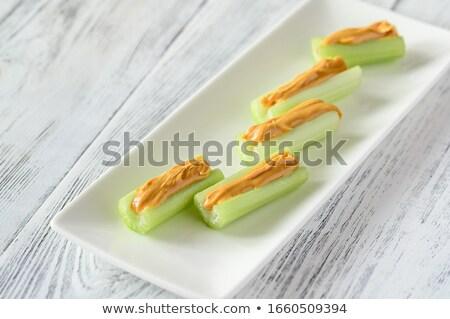 Sedano burro di arachidi piatto sfondo colore Foto d'archivio © Alex9500