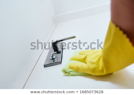 Person With Gloves Disinfecting Door Knob Using Sanitizer Stock photo © diego_cervo
