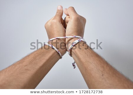 Tied with rope hands Stock photo © AndreyKr