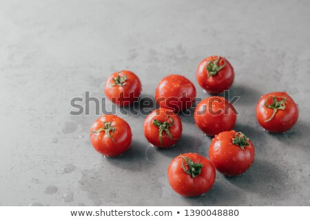 Concept of healthy eating. Fresh red tomatoes with rain drops for making delicious vegetarian meal.  Stock photo © vkstudio
