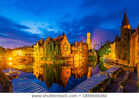 Brugge Belfry tower and Grote markt square in Bruges, Belgium on sunset Stock photo © dmitry_rukhlenko