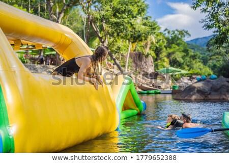 Mulher inflável piscina festa feliz Foto stock © galitskaya