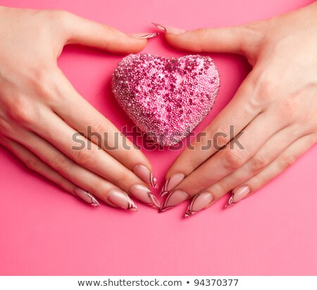 two hands with long acrylic nails stock photo © dolgachov