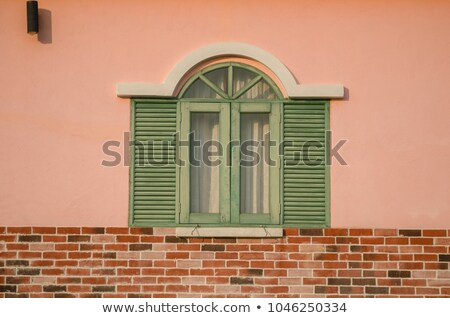 Vintage wall and windows in orange background Stock photo © kawing921