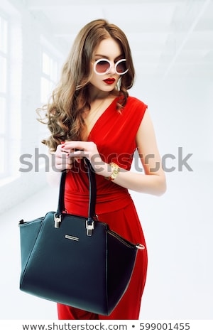 girl wearing elegant dress and purse Stock photo © feedough