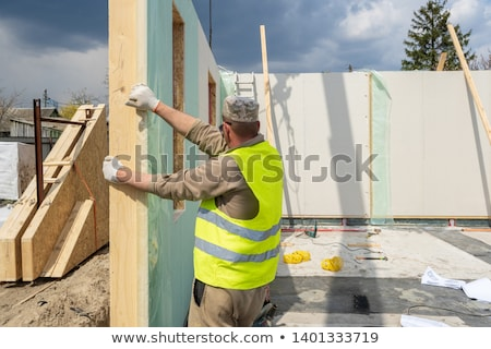 Montage of builder working on housing project Stock photo © photography33