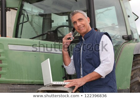 farmer near a tractor with computer Stock photo © photography33