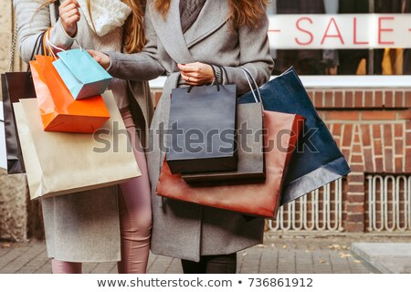 close up of two girls with shopping bags stock photo © photography33