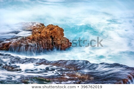 Fresh water flowing over the rocks to the ocean Stock photo © chrascina