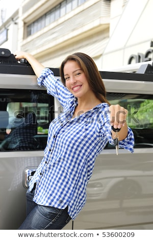 rich woman showing keys of her new bulletproof car Stock photo © mangostock