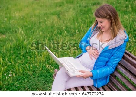 elfoglalt · női · diák · dolgozik · laptop · egyetem - stock fotó © annakazimir