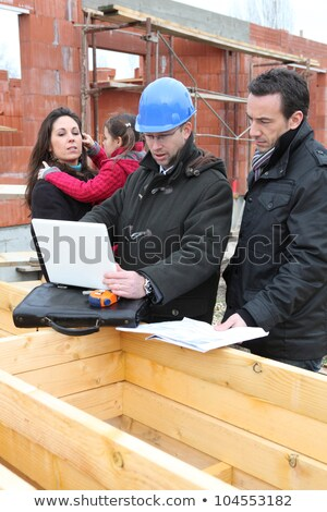 family inspecting there unfinished future home stock photo © photography33