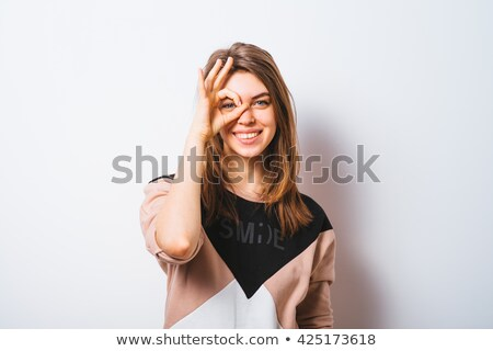 woman with binoculars looking shocked stock photo © sumners