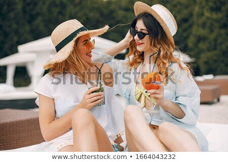 pretty blonde in bikini and fashion summer hat Stock photo © carlodapino