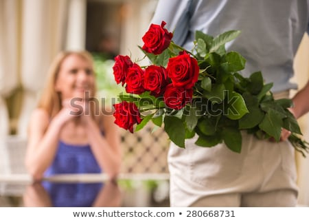 man gifting a dress and flowers to a woman Stock photo © Toivo