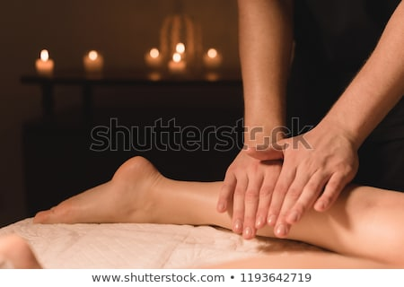 Masseur doing a reflexology massage in a room Stock photo © wavebreak_media