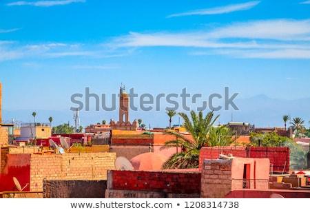 Minarete mesquita centro Marrocos pôr do sol viajar Foto stock © rmarinello