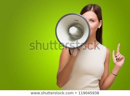 Businesswoman speaking in a megaphone against white background Stock photo © wavebreak_media