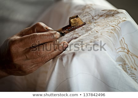 Batik painting on a white cloth process Stock photo © pzaxe