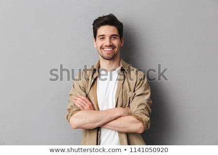 portré · jóképű · fiatal · üzletember · áll · kezek - stock fotó © HASLOO