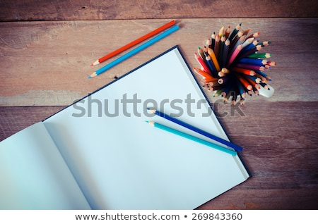Colorful pencils wall on empty white notebook sheet stock photo © make