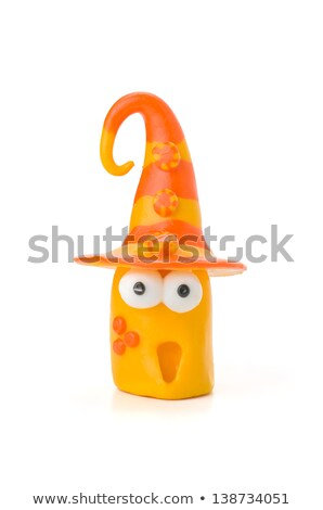 Handmade Modeling Clay Figure With Buttons On The Hat Photo stock © Zerbor