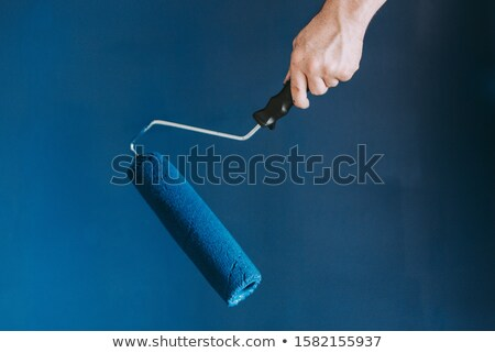 woman using paint roller stock photo © photography33