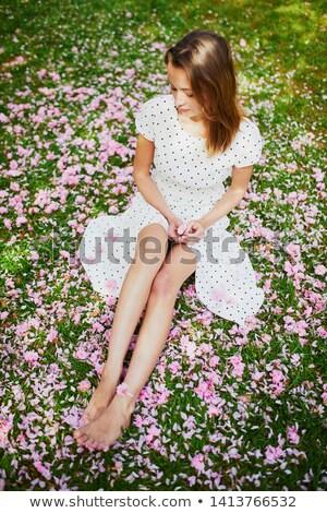 woman legs with flowers stock photo © kurhan