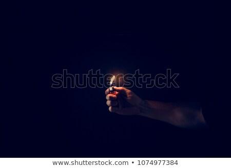 Mano luce accendino primo piano fuoco uomo Foto d'archivio © jackethead