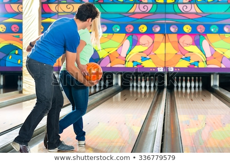Man Teaching Woman Bowling Stock photo © Jasminko