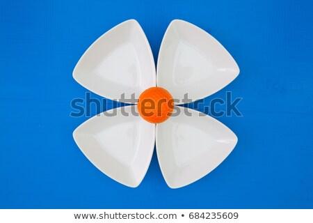 white ceramics bowls and orange golf ball stock photo © capturelight