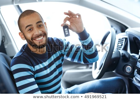 Happy owner of a new car showing a key. Stock photo © Nobilior
