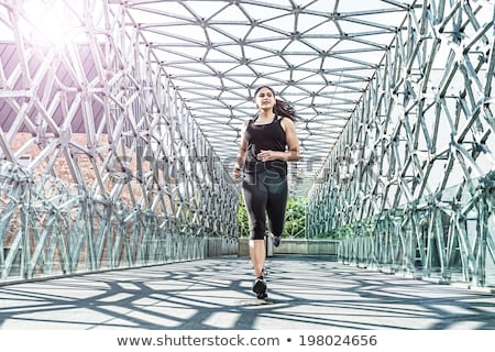 Abstract - Beautiful woman running on a modern metal bridge Stock photo © Geribody