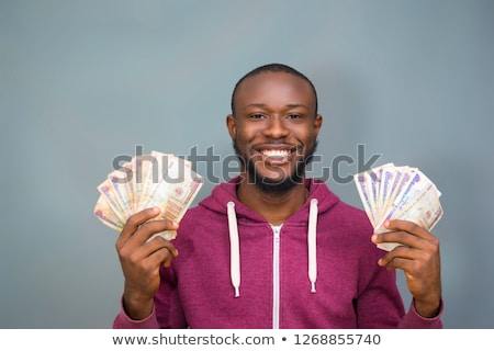 businessman smiling and holding money Stock photo © Flareimage