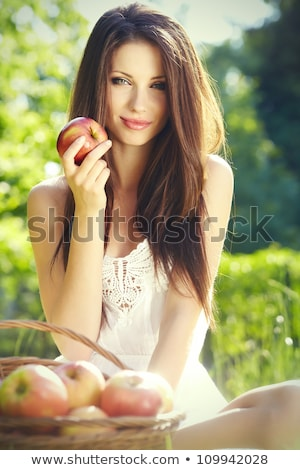 close up pretty woman biting sweet red apple stock photo © dash